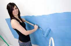 Happy Home Maker Blue Painting Using Roller Stock Photo
