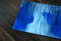 Blue painting brush and candle in candlestick. Studio scenes, the picture in the process, the cozy atmosphere of the Studio Royalty Free Stock Image