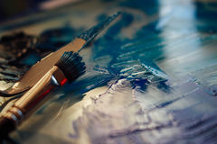 Blue paints and pallet Royalty Free Stock Photos