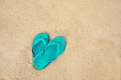 Blue pair of flip flops on the beach Stock Photo