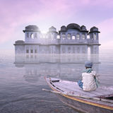 Blue palace. Blue palace on the Ganges river in the sunrise Stock Image