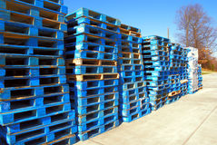 Blue palettes. Stacks of mainly blue wooden shipping palettes Stock Photo