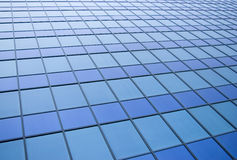 Blue panels. On the side of a large building royalty free stock image