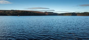 Blue Panoramic Lake Landscape. A panoramic landscape of a blue reservoir Royalty Free Stock Photography