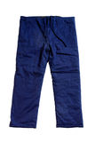 Blue pants. A pair of blue pants isolate on white background Stock Photography