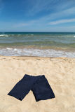 Blue pants on the beach Stock Image