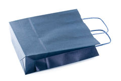 A blue paper bag. On white Stock Images