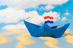 Blue paper boat Stock Image