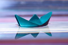 Blue paper boat Stock Photos