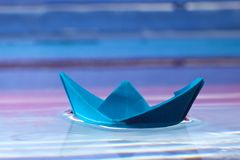 Blue paper boat Stock Photography