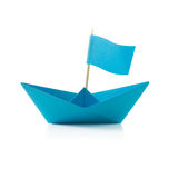 Blue paper boat with flag. Origami blue paper boat with flag on white background stock photography