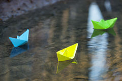 Blue paper boat in water royalty free stock image