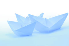 Blue Paper boats. On white or blue background royalty free stock photo