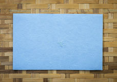 Blue paper card on bamboo pattern background Royalty Free Stock Images