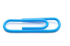 Blue paper clips. Isolated on white background royalty free stock images
