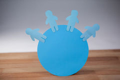 Blue paper cut-out people on the circle. Conceptual image of blue and paper cut-out people on the circle Royalty Free Stock Photos