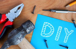 Blue paper with diy Do It Yourself Stock Photos