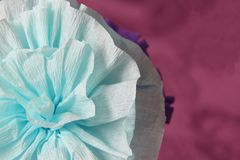 Blue paper flower on violet background. Blue paper carnation. Handmade decoration Stock Photography