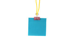 Blue  paper hanging on a rope. Paper hanging on a rope on an isolated background Royalty Free Stock Photos