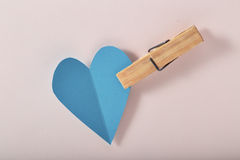 Blue paper heart on pink paper. Background royalty free stock image