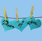 Blue paper hearts on clothespins with inscription - Dream of you Stock Photos