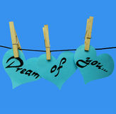 Blue paper hearts on clothespins with inscription - Dream of you Royalty Free Stock Images
