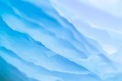Blue paper layers background blur sea waves effect. Closeup of blue paper layers stack abstract art background. Blur sea waves effect. Copy space royalty free stock image