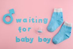 Blue letters, socks and pacifier stock photography