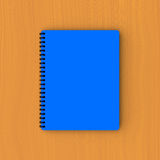 Blue paper notebook on plywood Royalty Free Stock Photo