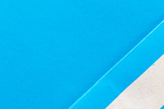 Blue Paper Notepad  on blue background Stock Photos