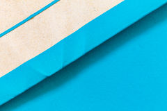 Blue Paper Notepad  on blue background Royalty Free Stock Photos