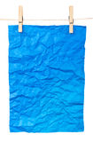 Blue paper-a poster on clothespins Stock Images