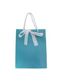 Blue paper shopping bag with white bow Stock Photos