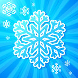 Blue paper snowflake on striped background Stock Image