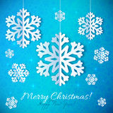 Blue paper snowflakes on ornate background Royalty Free Stock Image