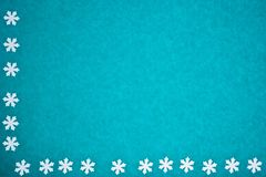 Blue paper texture with snowflakes as background royalty free stock image
