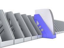 Blue paper tray stands out among the paper trays Royalty Free Stock Photos