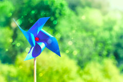 Blue paper weathercock on nature background Stock Photo