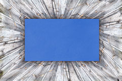 Blue Paper on wood Stock Photography
