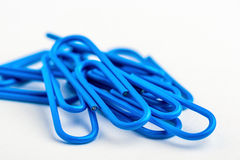 Blue paperclips Stock Photo