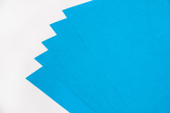 Blue papers for origami on the white background Stock Image