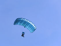 Blue parachute. A blue parachute on a bright sunny day Royalty Free Stock Photography