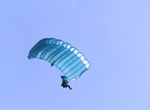Blue parachute. A blue parachute on a bright sunny day Royalty Free Stock Images
