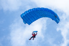 Blue parachute. A blue parachute on a bright sunny day Stock Photo