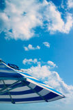 Blue parasol under sky Royalty Free Stock Photo