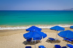 Blue parasols at Aegean Sea Stock Photography