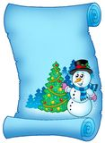 Blue parchment with snowman and tree Royalty Free Stock Images