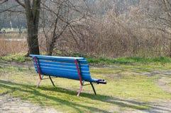 Blue park bench Stock Image