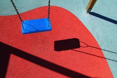 Blue park swing or red floor children playground Stock Images