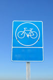 Blue parking bicycle sign on blue sky background. Royalty Free Stock Images